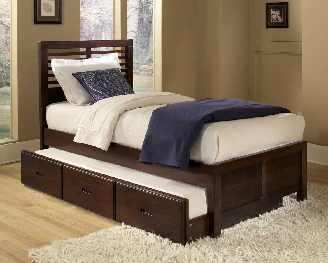 modern trundle beds made of wooden featuring three drawers and wooden laminating floor and modern rug