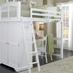 Modern white bunk with white desk white chair and white stairs floral bedroom rug in white