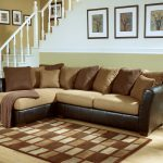Most comfortable sectional sofa with chaise together with brown decorative cushions made of comfort fabric plus square motif rug