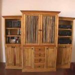 Old look and cool vintage entertainment center with door shelves and base storage
