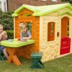 Outdoor playhouse from Tikes which is completed with built in table and a pair of X base small benches