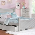 Pink wall paint color grey bed frame with storage and headboard and also footboard grey bedside table with drawers bedroom vanity with grey framed mirror tall cabinet system in grey white rug