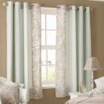 Pretty White Patterned Curtains With Armchair Table Lamp And Cushion