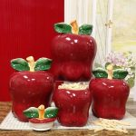 Pretty-red-kitchen-canister-set-with-red-apple-shaped-with-chic-green-leaves-detail-and-made-of-ceramic-placed-near-window-kitchen