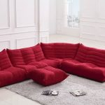 Red microfiber sectional without legs white shag rug