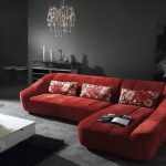 Red sectional sofa sleeper with throw pillows modern white coffee table with shelf and drawer underneath crystal pendant lamp in classic style