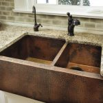 Rustic double copper farm sinks with black wrought iron water faucets in different style granite kitchen countertop