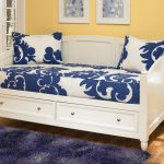 Simple White Daybeds with Storage And Blue White Pattern Bedding And Fur Rug
