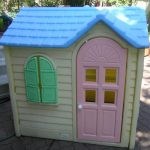 Simple little tikes playhouse with cute pink door and green window