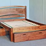 Solid wood low profile bed frame with storage and traditional styled headboard