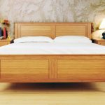 Solid wood platform bed frame  with headboard white bedding set a pair of solid wood bedside tables with drawers