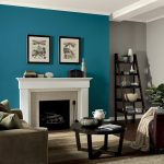 Teal Living Room Decor Of Wall With White Fireplace And Wooden Ladder Shelves
