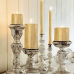 The Series Of Mercury Candlestick Stands With Mercury Decorative Balls In Different Size