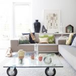 Transparent glass top coffee table with casters