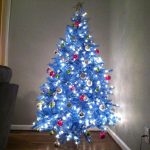 Tree With Blue And White Christmas Lights On Room Corner
