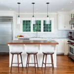 Triple Kitchen Pendant Light Fixture And Wooden Stool For Minimalist White Kitchen