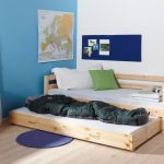 Unfinished wooden double trundle bed idea with a pair of drawers an unfinished wooden stoarge round blue navy rug for bedroom