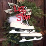 Vintage Winter Wreath With Using A Pair Of Children's Vintage Ice Skates And Glitter Letters And Ribbon And Greenery Hang On The Front Door For Christmas Decoration