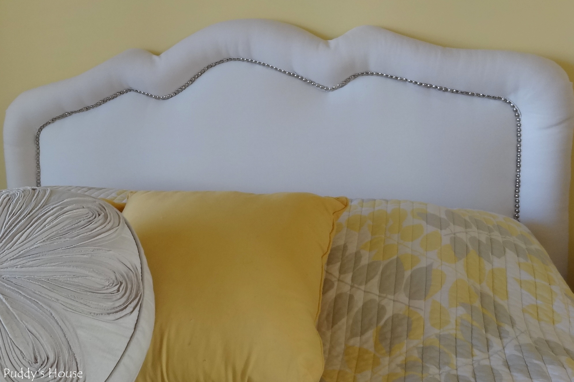 cheap white diy upholstered headboard with nailhead trim and yellow white pillows with diy upholstered headboard