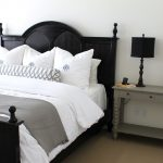White Restoration Hardware Linen Sheets With Black Wooden Bed Frame
