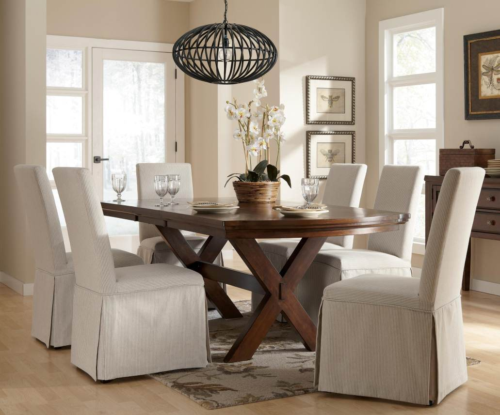 White Slip Cover For Chair With Wooden Table And Unique Chandelier