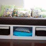 White Wooden Daybeds with Storage For Pillows With Brown Mat And Floral Pillows
