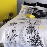 White comforter cover with beautiful floral motif designed by IKEA