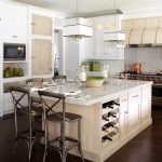 White kitchen island with under storage and wine rack idea some dark silver painted barstools unique and modern white pendant lamps