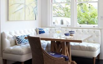 White upholstered bench kitchen set glossy wood top table in square shape and a rattan chair with blue cushion