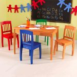 Wood table and fun colored wood chairs for kids dark brown framed chalkboard and beautiful wall decoration