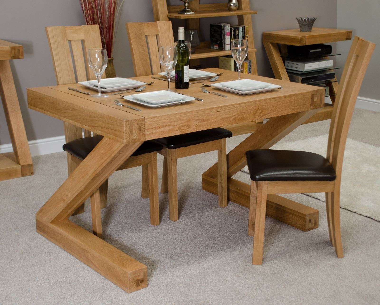 Wooden space saver dining set with cushion on chair and unique table bases
