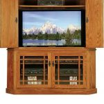 Wooden entertainment center with door and glass door cabinet at the base