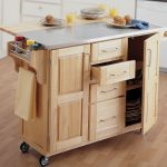 Wooden kitchen cart on wheels with base storage system