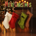 a-charming-Merry-Christmas-stocking-holder-stand-with-colorful-stockings-and-colorful-words-of-merry-christmas-also-with-4-hooks-placed-near-christmas-tress