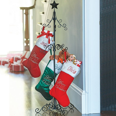 A Christmas Stocking Holder Stand Features Scrolled Detailing