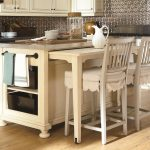 a-kitchen-island-with-pull-out-table-from-solid-wood-veneers-and-with-stainless-steel-top-and-counter-height-pull-out-table-for-quick-meals-by-universal