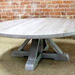 a-rustic-and-a-beachy-flair-of-the-driftwood-oak-coffee-table-with-gray-pedestal-base-in-round-shape-and-in-whitewash-top
