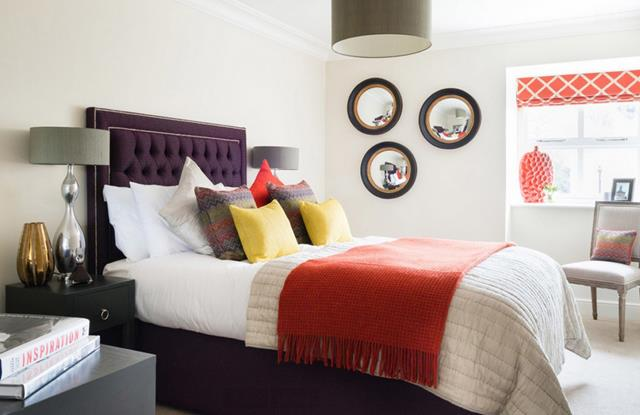 adorable bedroom interior design with spring mood idea with round wall mirrors and purple bedding with orange and yellow throw