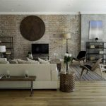 adorable interior design with cream sectional sofa idea and brick wall and patterned area rug and wooden floor and wooden bench