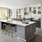 adorable kitchen design with open concept and gray cabinetry and concrete flooring and glass window and door and black round leather chairs