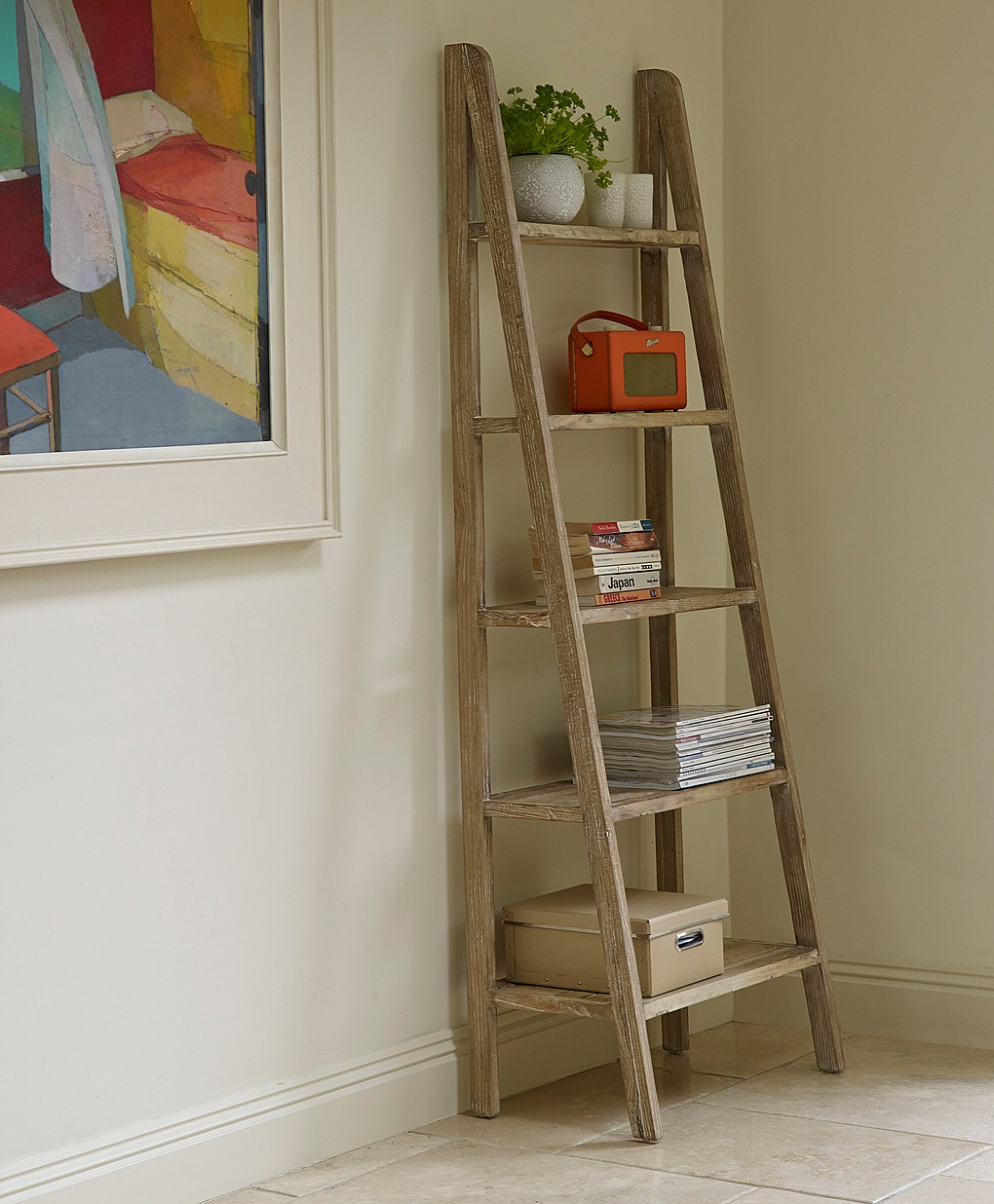adorable ladder shelving unit made of woods plus 5 shelves beautified with  greeneries and book collection