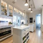 Adorable Luxurious Kitchen Mansion Design With Upper Glasss Cabinet And Wooden Floor And Small Island And Simple Cabinet