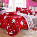 adorable red hello kitty bedding design with wooden laminated floor and pink wall paint and white faux fluffy rug