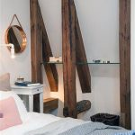 adorable rustic wall shelves design with round wall mirror and pink pillow and white end table and bedding and blue sheet