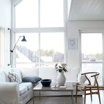 adorable small white scandinavian interior design with white sofa idea and rectangle coffee table and wooden chair and sloping ceiling