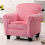 adorable soft velvet pink accent chair design with black carved legs with bold backrest
