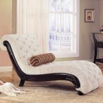 adorable white tufted upholstered small chaise lounge design with long throw pillow on creamy area rug