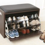 amazing black shoe storage in the entry with bold black bolster on creamy floor