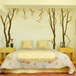 amazing floral patterned wall decor in a bathroom with lovely blue spring sheet with creamy pillows and end tables
