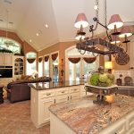 amazing living room and kitchen with pot rack with lights on the top of kitchen island with strong marble countertop